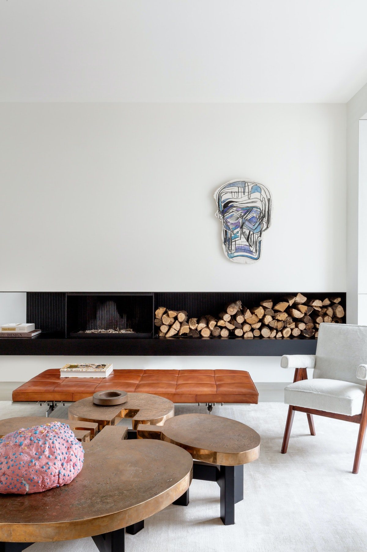 home interior, coffee table, chair, art