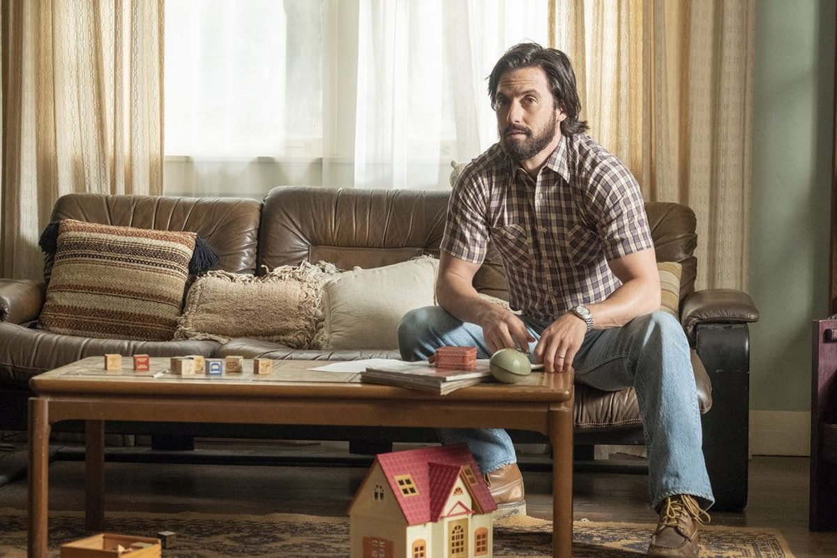 Milo Ventimiglia as Jack watching TV on This Is Us