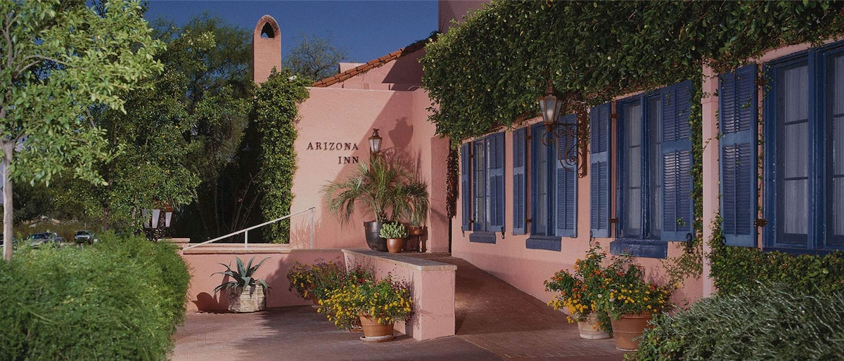 Front of Arizona Inn, a historic boutique hotel retreat that's painted pink.