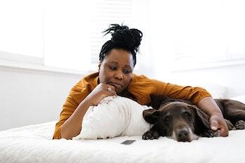 Sad woman with depressed dog