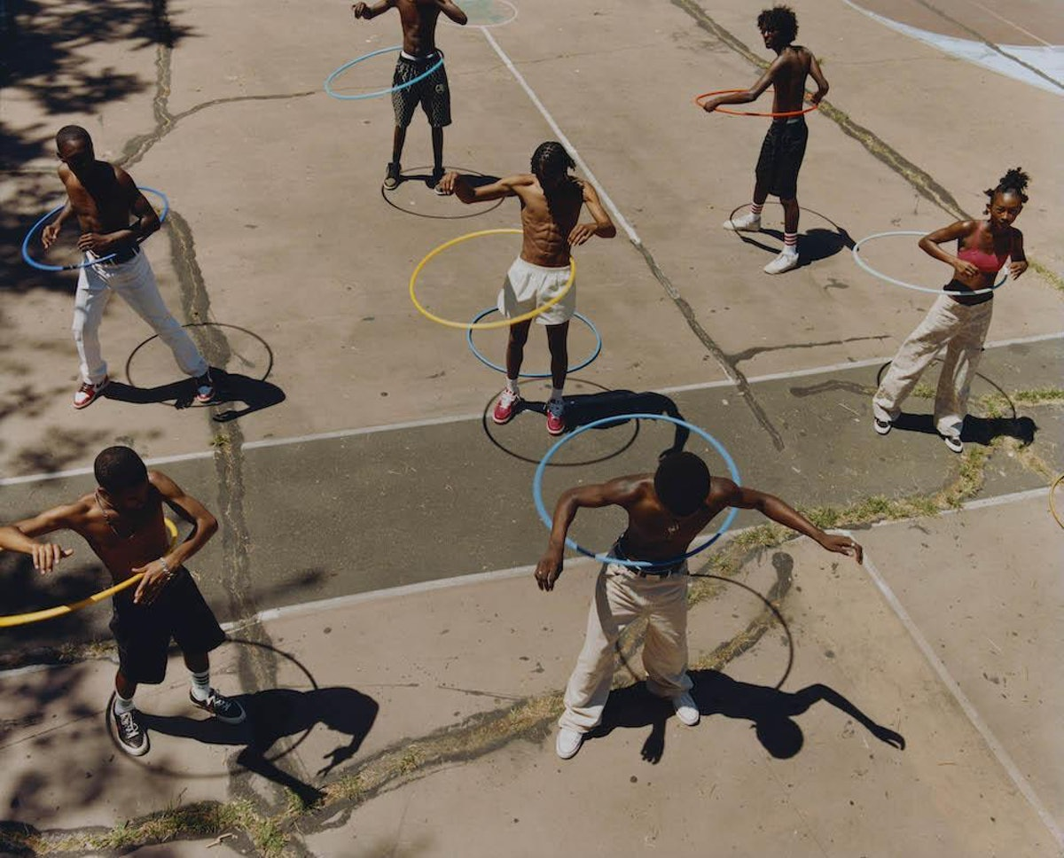 A photograph of people hula-hooping by Tyler Mitchell