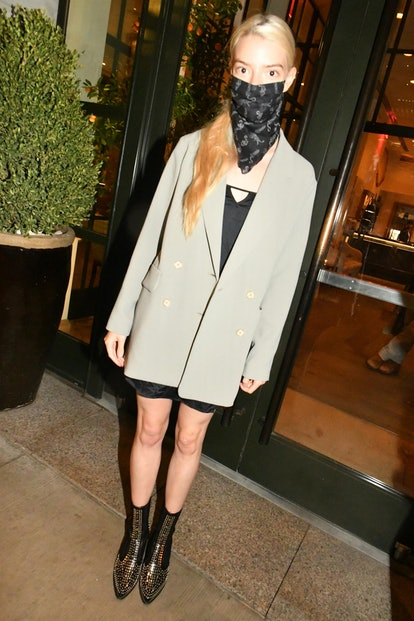 """""""The Queen's Gambit"""" star Anya Taylor-Joy happily poses with fans as she leaves dinner in NYC on Monday night."""