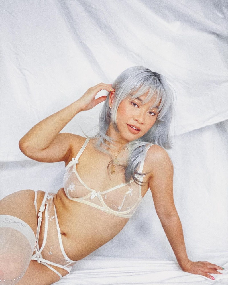 Model wearing Savage X Fenty bridal lingerie.