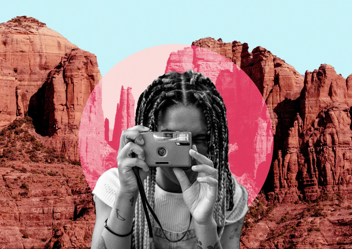 Young woman snapping a picture in front of one of the most Instagram-worthy pink places in Arizona.