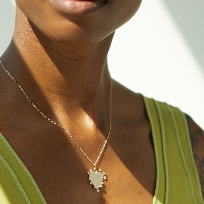 Model wears Heart Charm Necklace from the Catbird x The RealReal colleciton.