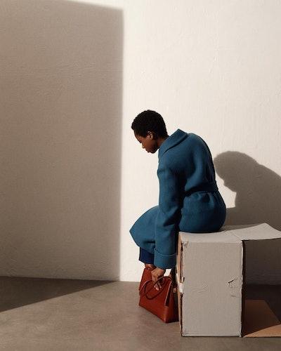 Model carrying a Yvonne Koné handbag.