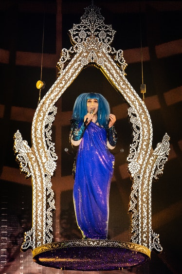 Cher performing in blue
