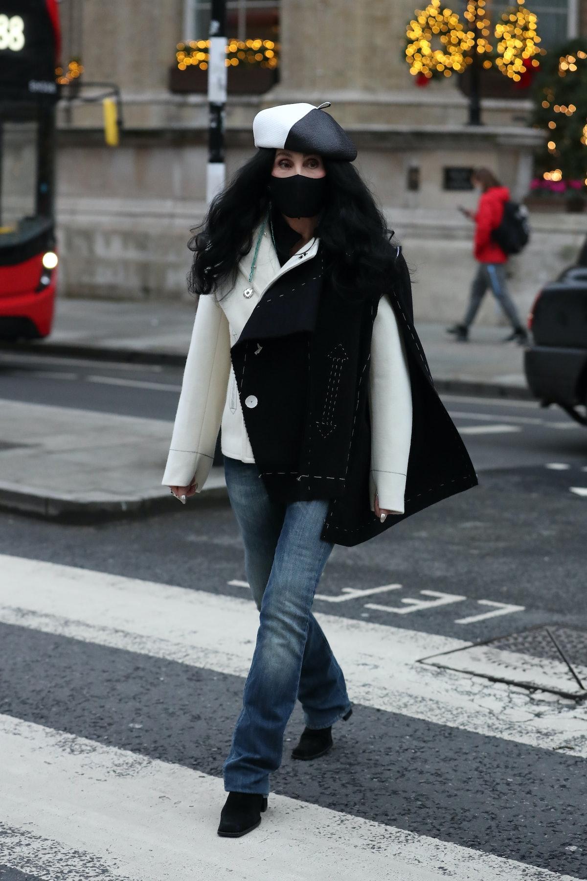 Cher crossing a street