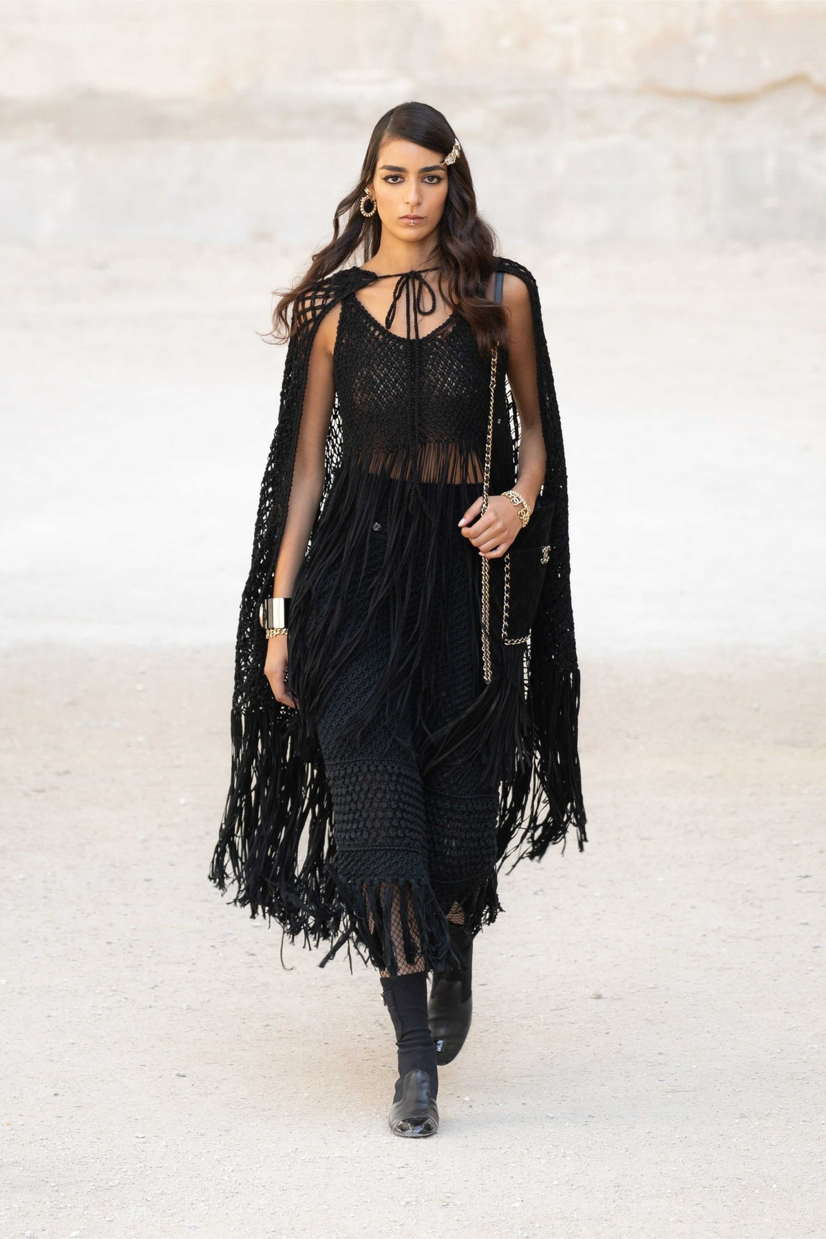 model in sheer black Chanel cape and dress