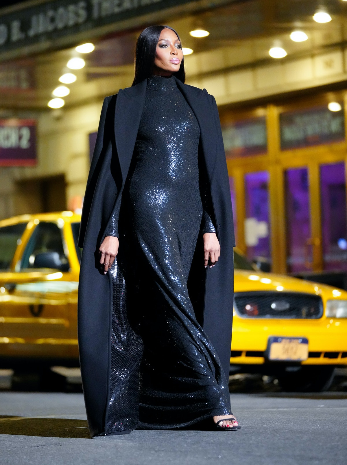 Naomi Campbell walking Michael Kors in a cape