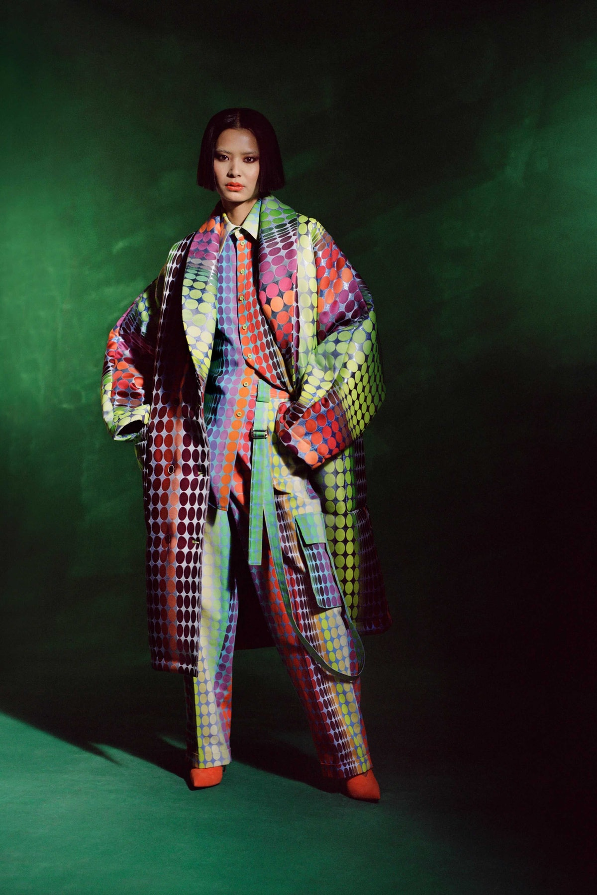 Model in colorful coat and matching set