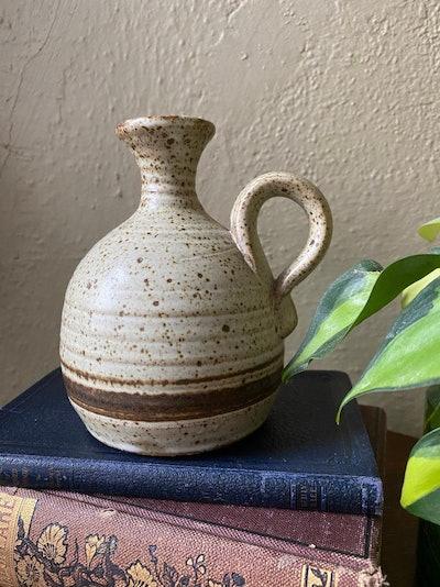 Vintage speckled handmade pottery bud vase with handle