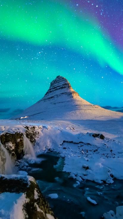 Northern lights at Mount Kirkjufell, Iceland.