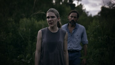 Lily Rabe (Emma), Enrique Murciano (Peter Guillory) in a field, distraught