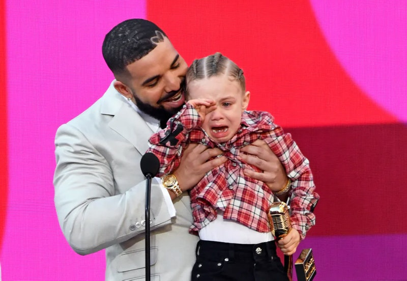 Drake, winner of the Artist of the Decade Award, and Adonis Graham speak onstage for the 2021 Billboard Music Awards, broadcast on May 23, 2021 at Microsoft Theater in Los Angeles, California.