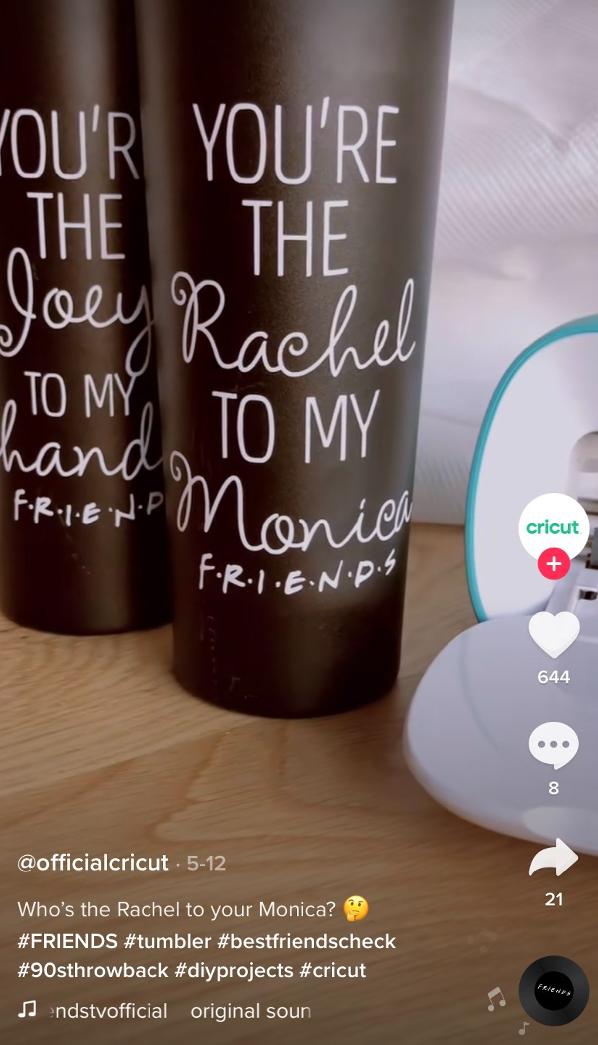 """A pair of """"You're the Monica to my Rachel"""" 'Friends' tumblers from Cricut's TikTok sit on the table."""