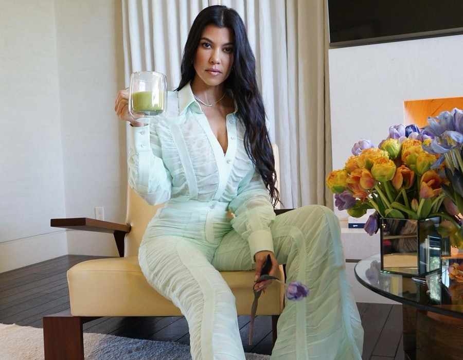 Kourtney Kardashian wears a green Salvatore Ferragamo suit.