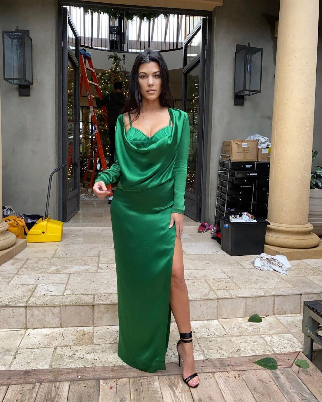 Kourtney Kardashian wearing a green Jean Paul Gautier gown.