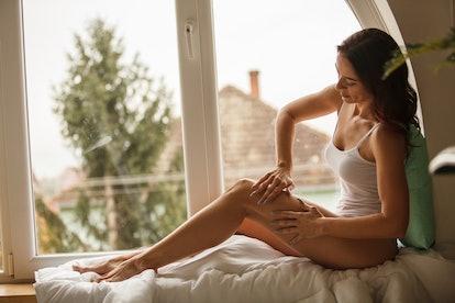 Woman massaging legs