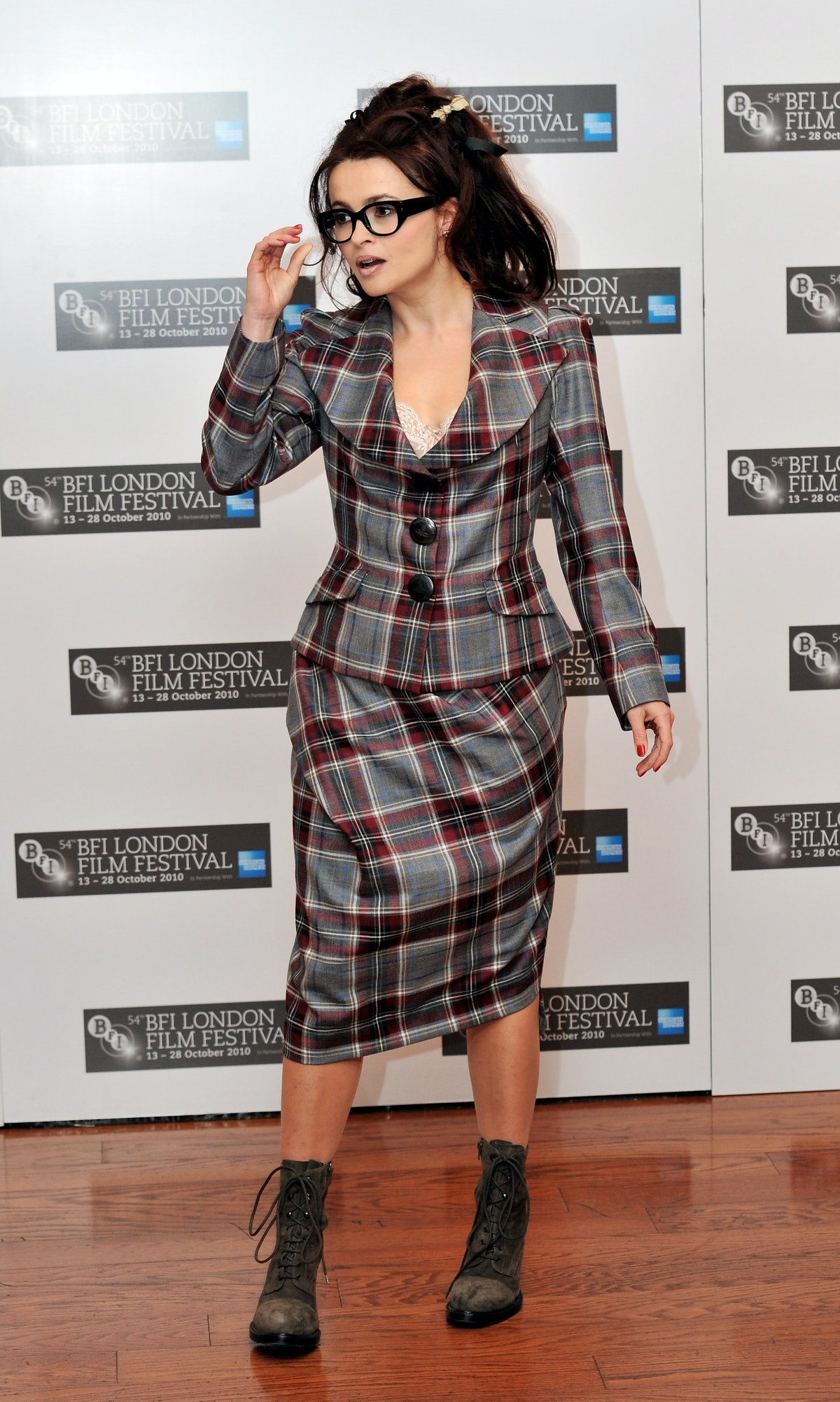 HBC in plaid skirt suit and glasses