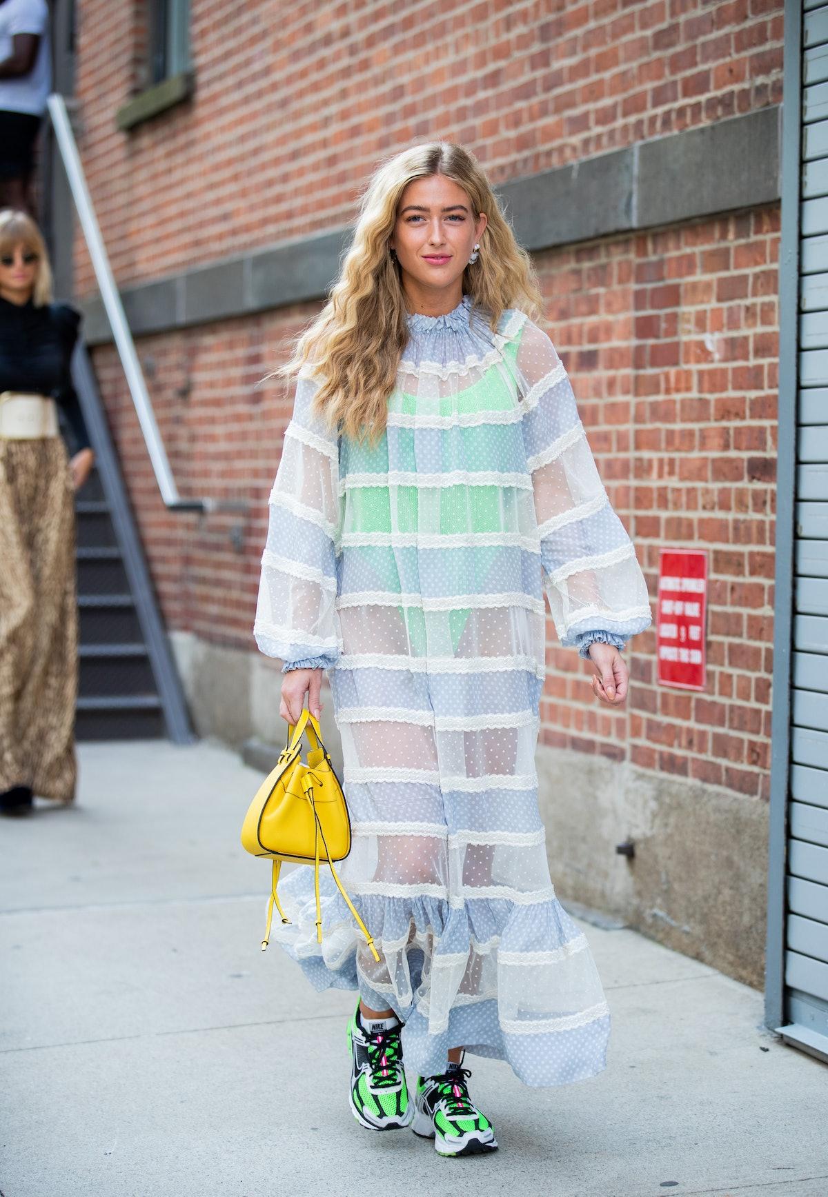Emili Sindlev is seen wearing a sheer dress outside Zimmermann during New York Fashion Week Septembe...