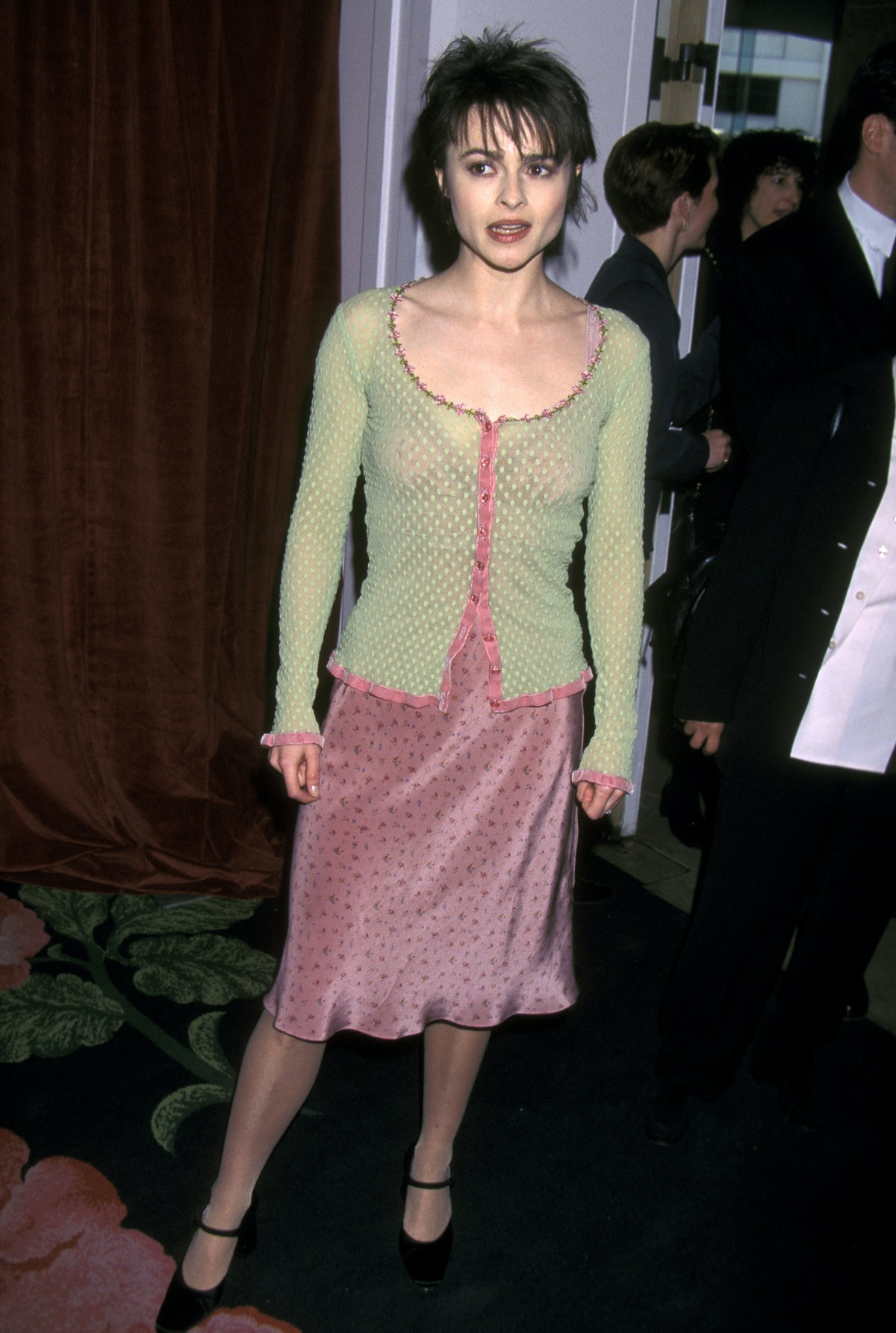 HBC in a green cardigan and pink dress