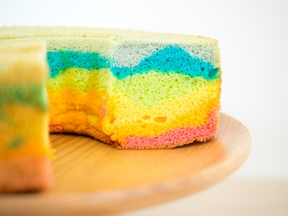 One layer of chiffon cake with rainbow coloring; sitting on wood cake stand