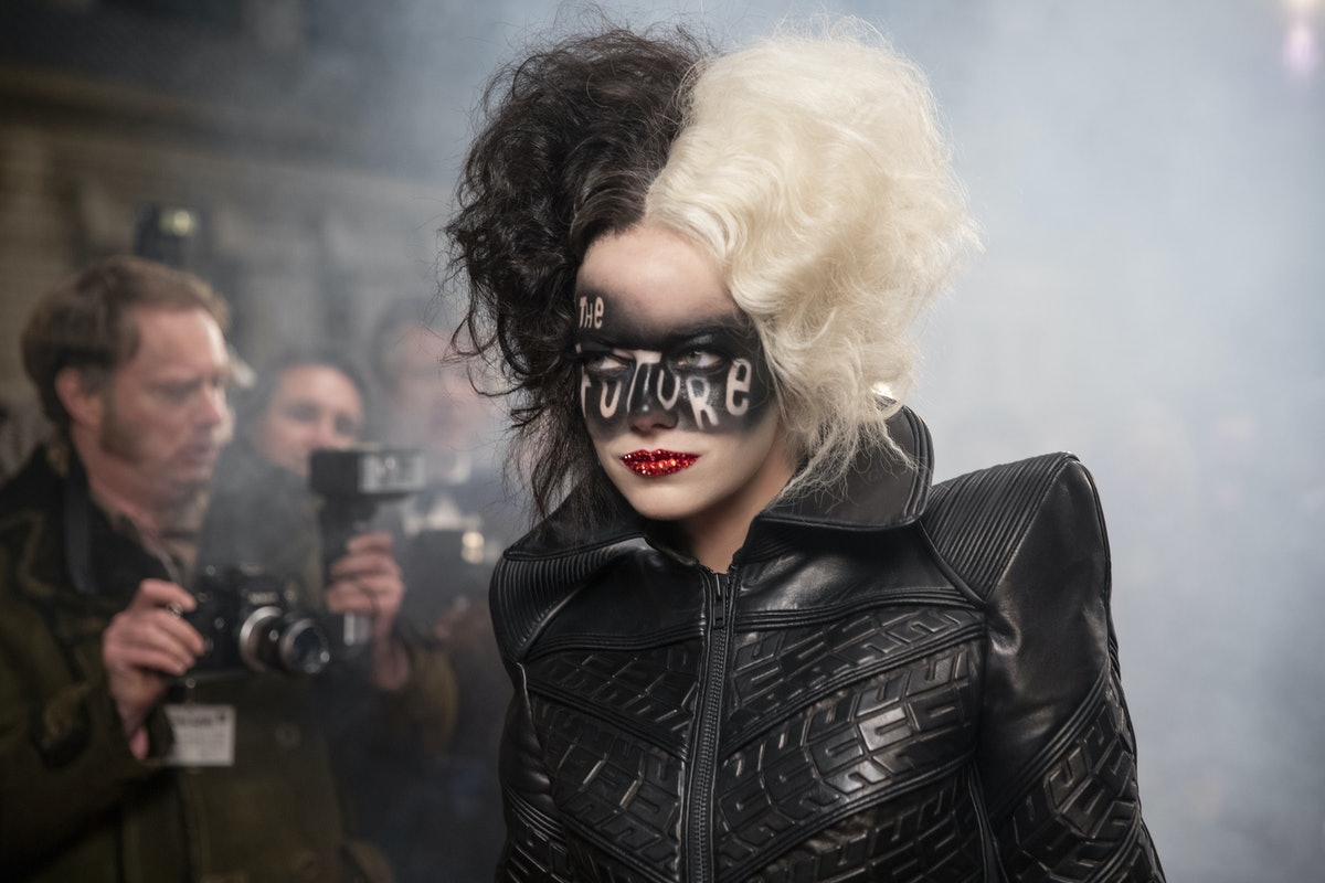 """Cruella with """"The Future"""" spray painted over her face"""