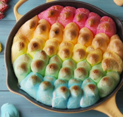 Iron skilled full of Peeps marshmallows in various colors, lightly toasted into a dip