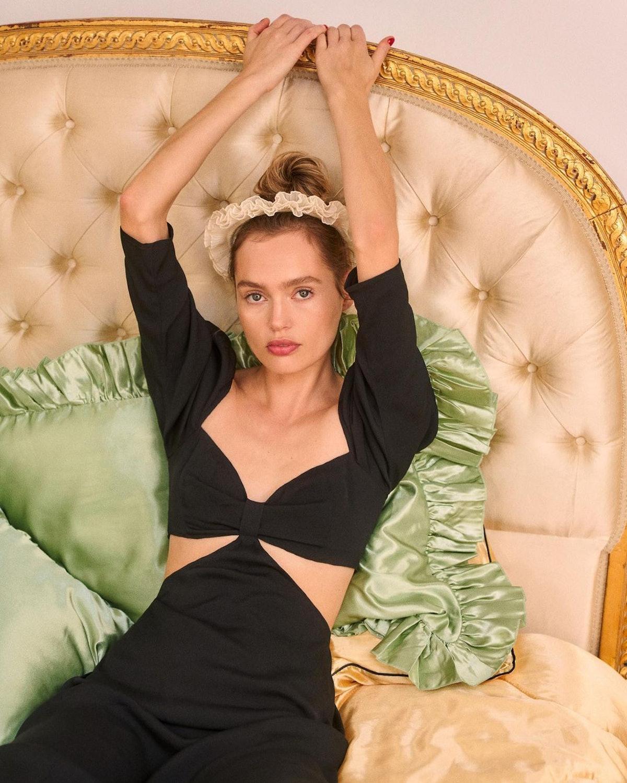 Model wearing Reformation dress.