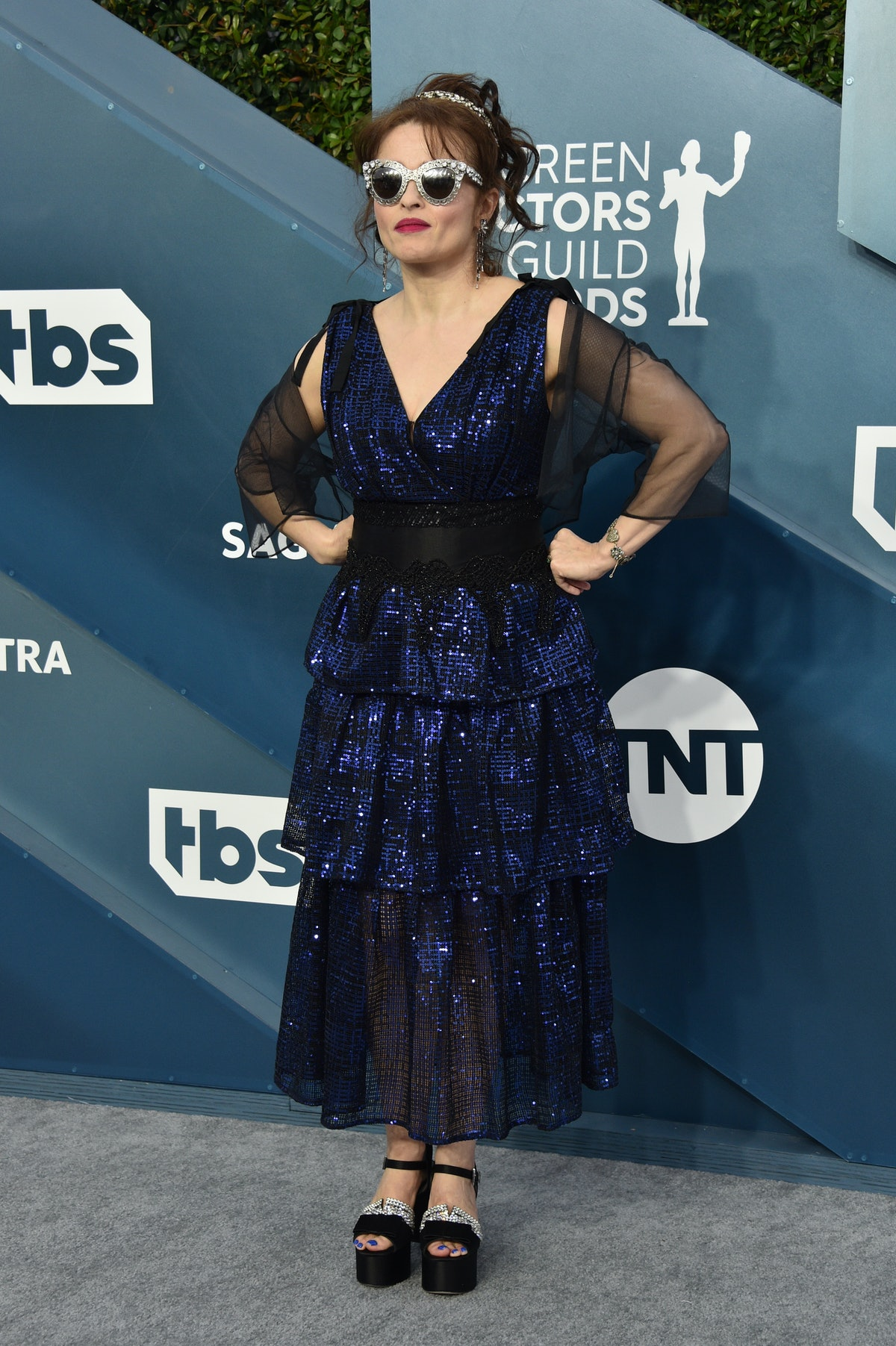Helena Bonham Carter in a blue gown and silver sunnies