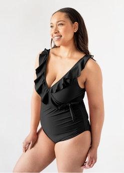 woman in ruffled postpartum swimsuit