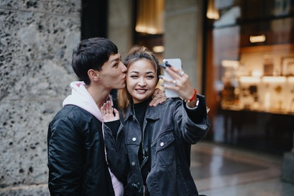 Young couple taking a selfie on the most romantic day in June 2021.