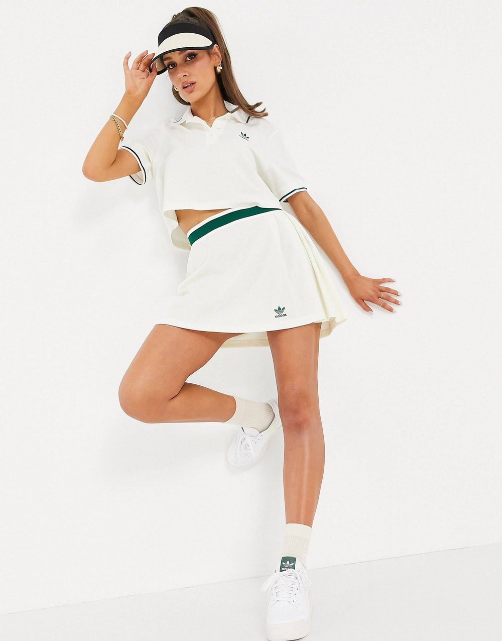 'Tennis Luxe' logo pleated skirt in off white