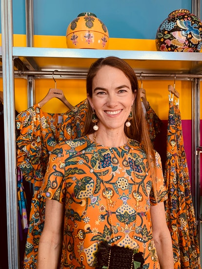 JJ Martin wearing an orange printed dress from her label La DoubleJJ and vintage jewelry