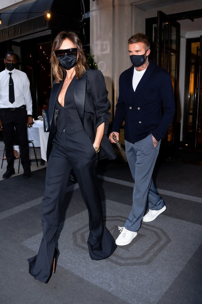 Victoria Beckham wears black tuxedo jacket and pants while out to dinner with David Beckham in New York City.