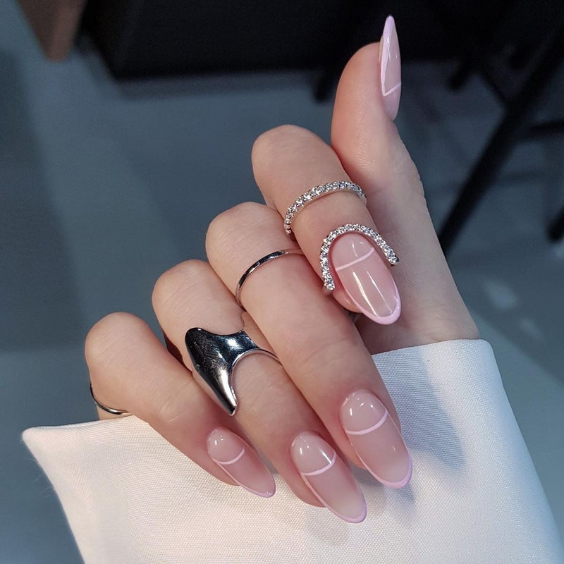 Fine line manicure with rings