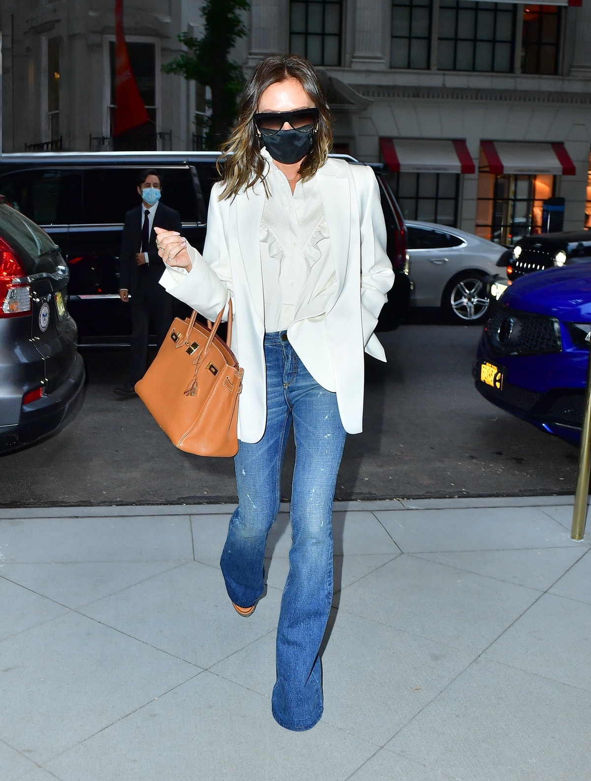 Victoria Beckham wears flared blue jeans while out in New York City.