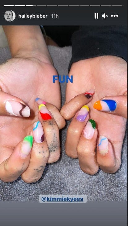 Hailey Bieber's nail art featured every color under the sun. It's part French manicure, part modern art, and completely cool.