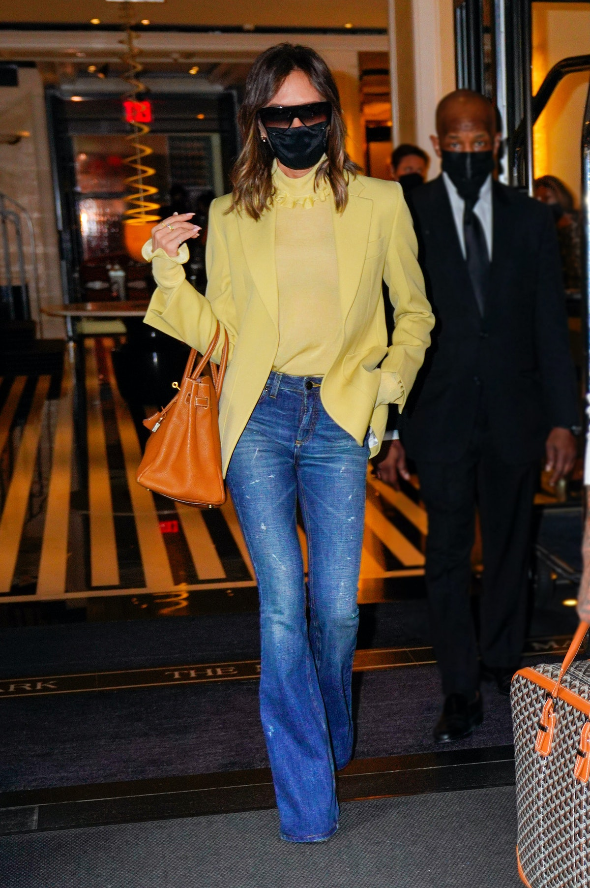 Victoria Beckham wearing yellow with jeans