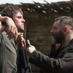 Dan Stevens and Michael Sheen in Apostle, one of many movies like Midsommar to rent or stream.