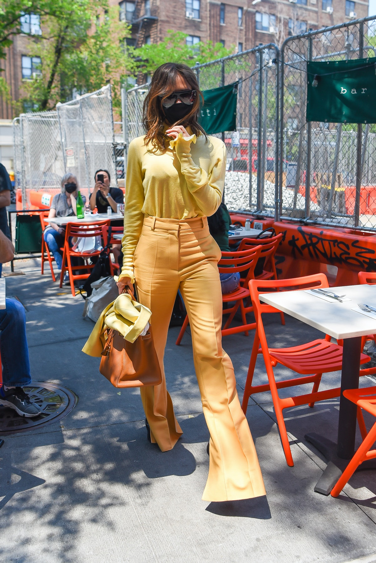 Victoria Beckham wearing all yellow