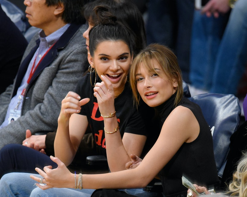 Best friends Kendall Jenner and Hailey Bieber attend a basketball game together.