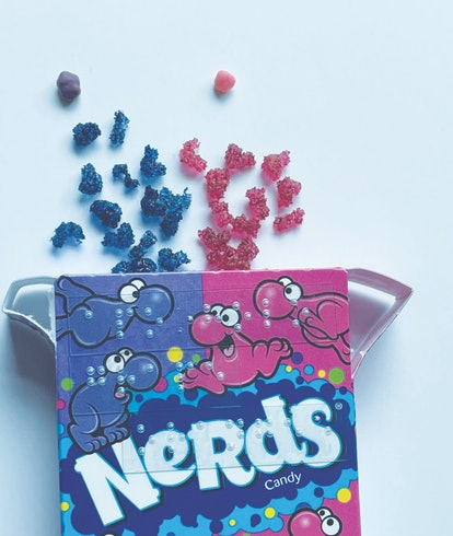 3D printed protein models next to Nerds candy, for size