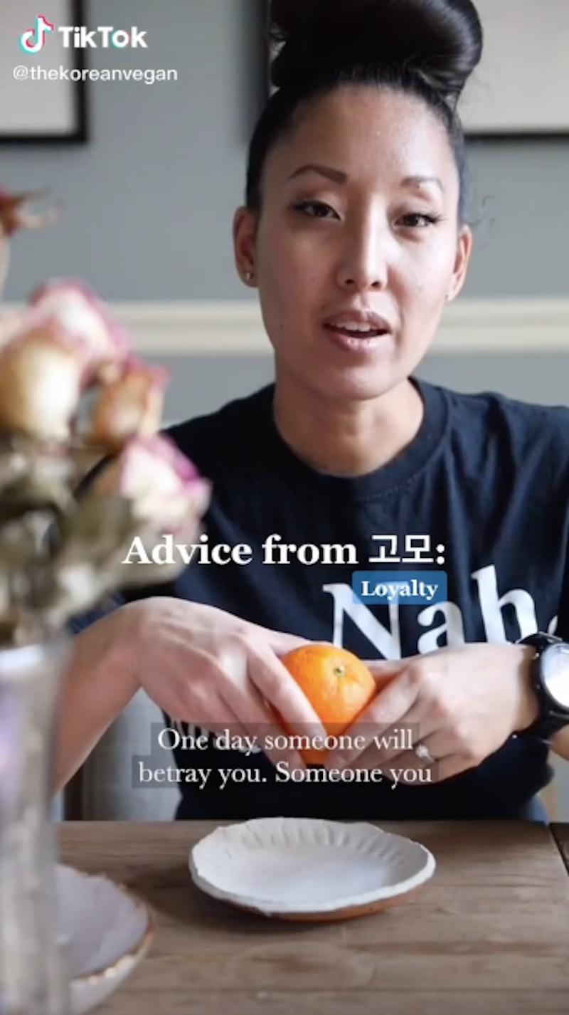 A screenshot of a TikTok where Joanne Molinaro, the Korean Vegan, dishes tough love while peeling an orange.