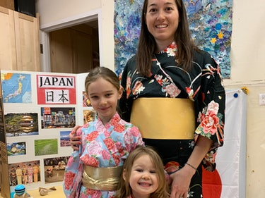 The author and her two young daughters; all are wearing kimonos.