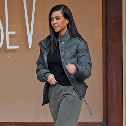 Kourtney Kardashian wears sweatpants and birkenstocks.