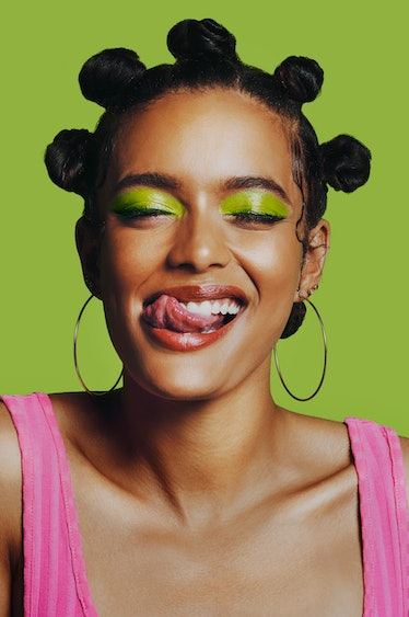 Young woman sticking her tongue out, having the best month of June 2021.