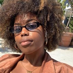 Woman wearing glasses & natural hair