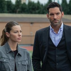 Chloe Decker (Lauren German) and Lucifer Morningstar (Tom Ellis) stand next to each other, looking s...
